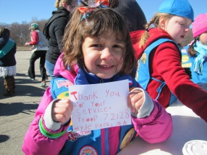 A Daisy from Hyde Park troop 72128 proudly displays her thank you note to the military community.