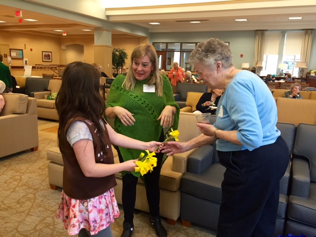 Brownie Troop 69134 greeted guests with yellow daffodils
